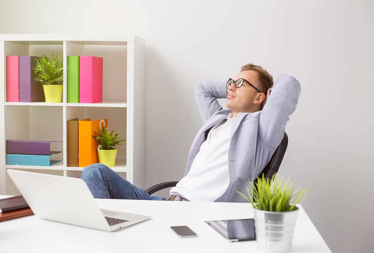 Relaxed-businessman-sitting-in-chair